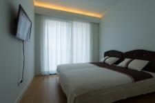 Apartman kod Bellvila i Simensa, spavaca soba sa posteljinom